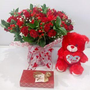 roses chocolate and teddy bear